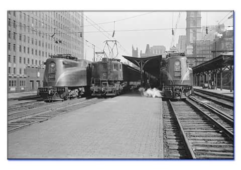 "Pennsylvania Railroad at Broad Street Station in Philadelphia in 1938. Streamlined electric locomotives are the classic ""GG1s"", a very beautifully designed locomotive."
